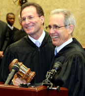 Joel Brown, left, is handed the gavel from Judge Farina